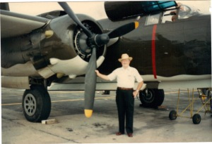 Dad holding the propeller of an A20G